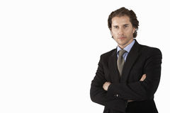 Businessman with arms crossed on white background portrait Stock Photography