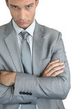 Businessman with arms crossed Stock Images