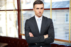 Businessman with arms folded Stock Photo