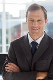 Businessman with arms folded Royalty Free Stock Image