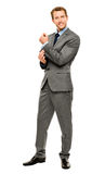 Businessman arms folded smiling isolated white background Stock Photo
