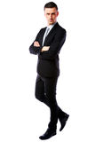 Businessman with arms folded walking Royalty Free Stock Images