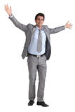 Businessman with arms out Royalty Free Stock Images