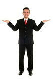 Businessman with arms raised. Young businessman with arms raised Stock Images