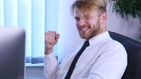 Businessman with arms raised celebrating success in office. close up.  stock video