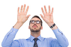 Businessman with arms raised and his fingers spread out Stock Images