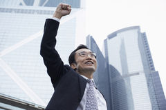 Businessman With Arms Raised Outdoors Stock Photos
