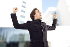 Businessman with arms up celebrating his success Royalty Free Stock Photos