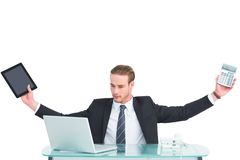 Businessman with arms up holding tablet and calculator Stock Images