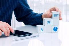 Businessman arranging small blocks. Stock Photos