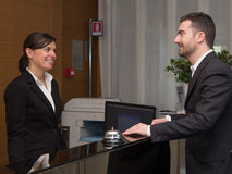 Businessman is arrived in hotel and is checking-in Stock Photography