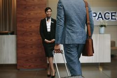 Businessman arriving at hotel for conference Stock Photography