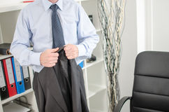 Businessman arriving at office. Businessman holding his jacket at office Royalty Free Stock Photos