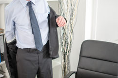 Businessman arriving at office. And taking off his jacket Royalty Free Stock Image