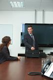 Businessman arriving to meeting room. Happy businessman arriving to meeting room, smiling Royalty Free Stock Photography