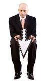 Businessman with arrow. Isolated image of a businessman holding a computer arrow cursor turned downwards Royalty Free Stock Photography