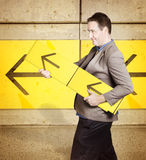 Businessman with arrow sign signalling growth Stock Photo