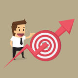 Businessman with arrow on through target Royalty Free Stock Photography