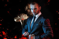 Businessman as an athlete fighter, alter ego Royalty Free Stock Images