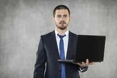 Businessman as a leader with a laptop Stock Image