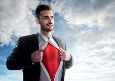 Businessman as superhero over sky background Royalty Free Stock Photo