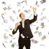 Businessman as a winner in a money rain Royalty Free Stock Images