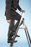 Businessman Ascending Corporate Ladder Stock Photos