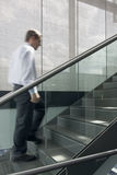 Businessman ascending stairs Stock Photo