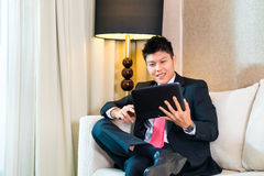 Businessman in Asian hotel room working Royalty Free Stock Photography
