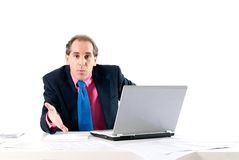 Businessman asking for explanations. With laptop on white background Royalty Free Stock Photo