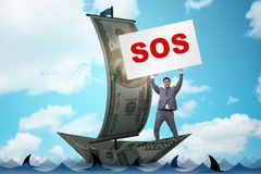 The businessman asking for help with sos message on boat. Businessman asking for help with SOS message on boat Stock Images