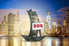 The businessman asking for help with sos message on boat. Businessman asking for help with SOS message on boat royalty free stock images