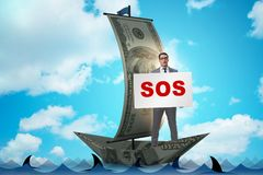 The businessman asking for help with sos message on boat. Businessman asking for help with SOS message on boat royalty free stock photos
