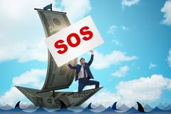 The businessman asking for help with sos message on boat. Businessman asking for help with SOS message on boat Royalty Free Stock Photography