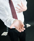 Businessman asking for money. Isolated on black background Stock Photos