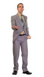 Businessman Asking For Money. Full body view of a young businessman asking for money with his hand out Royalty Free Stock Image