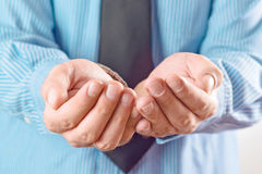 Businessman asking for money. Businessman begging with his cupped hands Stock Photography
