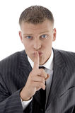 Businessman asking to keep silent Royalty Free Stock Image