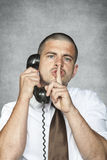 Businessman asks for silence. Business man asks for silence Stock Images
