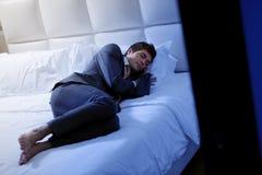 Businessman Asleep In Bedroom Stock Photos