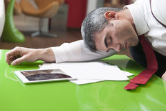 Businessman asleep on documents Royalty Free Stock Photo