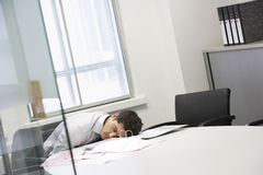 Businessman Asleep At Office Desk Royalty Free Stock Photography