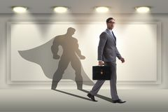 The businessman with aspiration of becoming superhero. Businessman with aspiration of becoming superhero Royalty Free Stock Image