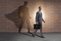 The businessman with aspiration of becoming superhero. Businessman with aspiration of becoming superhero stock photos