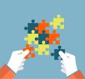 Businessman assembling jigsaw puzzle Royalty Free Stock Photo