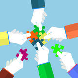 Businessman assembling jigsaw puzzle Stock Photo