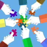 Businessman assembling jigsaw puzzle Stock Photography