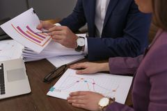 Businessman and assistant working with documents at table royalty free stock photography