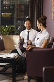 Businessman and assistant working at hotel lobby Royalty Free Stock Images