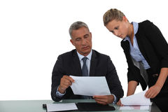 Businessman and assistant working Royalty Free Stock Photo